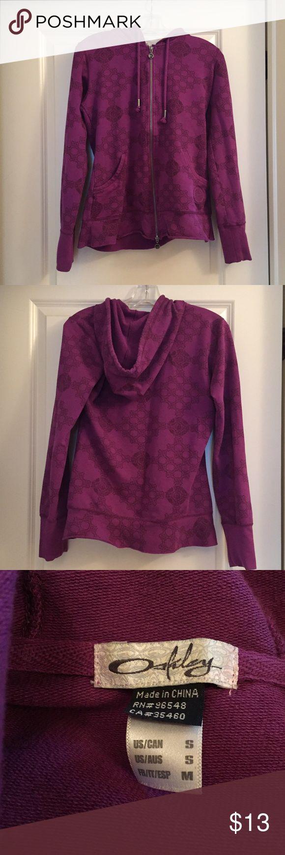 Oakley Hoodie Sweatshirt Zipper Front Small Oakley brand purple zip up hoodie jacket. Size small. Great condition with a simple honeycomb style print. Oakley Tops Sweatshirts & Hoodies