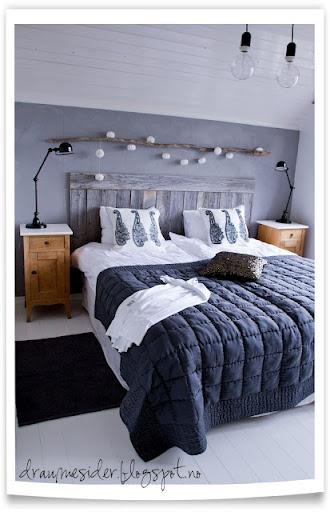 Une idée de tête de lit sympa faite d'une guirlande lumineuse et d'une branche  http://climsom.com