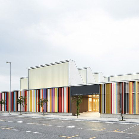 """""""Berriozar Nursery School"""": Colored louvers line the perimeter of this nursery school near Pamplona, Spain. Reminiscent of crayons, the colorful strips provide secure playground areas while letting in filtered light. 
