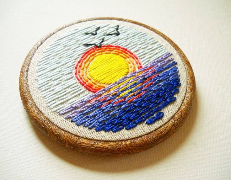 My sunrise hoop has a similar feel by using bold graphics and blocks of color.