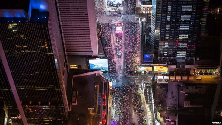 "In this aerial image over Midtown, Manhattan, revellers are seen taking part in New Year""s Eve celebrations in Times Square (five hours behind Greenwich)"