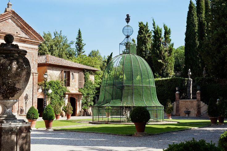 Walk around the beautiful courtyard at Relais La Suvera, Tuscany