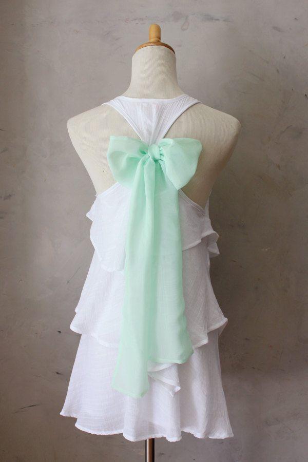 White ruffles, mint bow