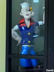 Popeye statue.There is a statue of Popeye at the Allen's Canning Co. corporate office in downtown Siloam Springs. It sat outside until vandals got to it, so now sits in the front window.