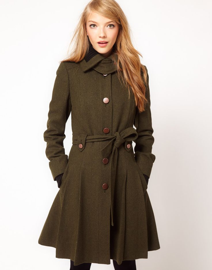 This military inspired jacket can be seen both on the runway and in mainstream fashion for the upcoming fall/winter seasons. The style and silhouette of this coat suggest a growing trend in combining influences of men's wear in women's clothing. The jacket has a masculine structure while still maintaining the feminine hourglass silhouette. We can also see this trend in the structure of women's pants and the popular button down collar shirts. Danielle M.