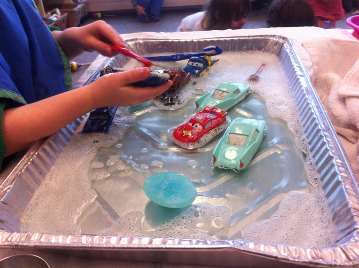 Car wash day! The kids in my preschool room are crazy about Cars (the movie ones) so instead of the typical car and mat activities I grabbed one of those throw away aluminum trays and an assortment of brushes and soapy water and away they went :)