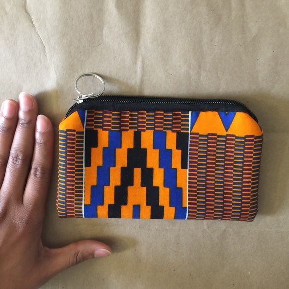 """West African """"Pagne"""" Print Bag New without tags! Beautiful print bag from West Africa. Approximately 6.5x4"""". Perfect makeup bag while traveling or to put your essentials everyday. Cotton exterior, lined with black leather interior. Zips shut. Removable keychain on zipper. Bags"""