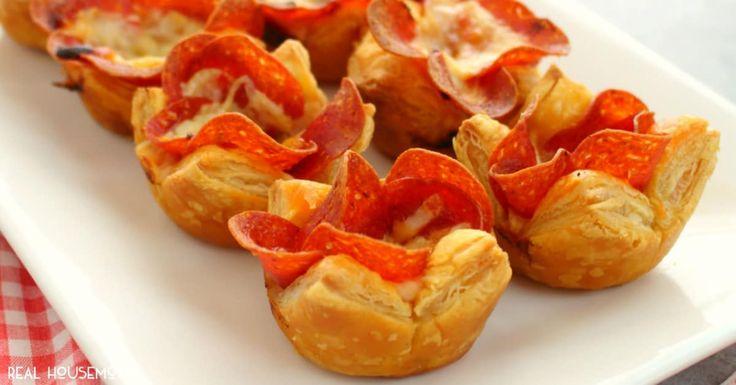 These Pepperoni Pizza Puffs are the perfect finger food for your next party! Made with 4 ingredients, these easy puff appetizers come together in moments.