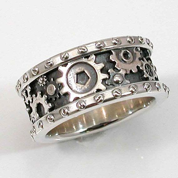 Steampunk wedding band for him on etsy  http://www.etsy.com/listing/90000730/steampunk-mens-silver-ring-gears-and