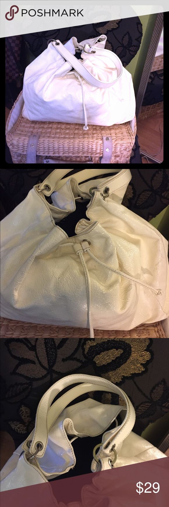 """KATE SPADE Large White Drawstring Purse Large white patent leather drawstring bag with double straps & polka dot lining. Bag is unstructured, but roughly measures 18"""" across & 12"""" deep.  Bag has faint marks on back of bag, as pictured, but are faint & not noticeable when drawstring is cinched, & is priced accordingly. Retails at $395 kate spade Bags"""