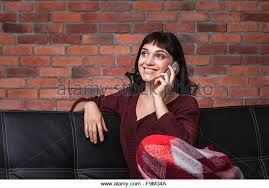 Image result for Mobile phone on couch