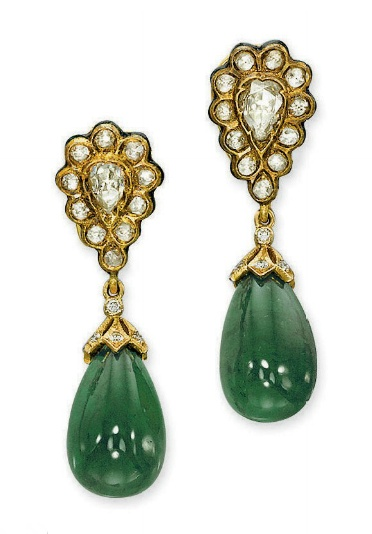 A PAIR OF INDIAN EMERALD AND DIAMOND EAR PENDANTS Each cabochon emerald drop with a diamond cap suspended from a pear-shaped rose-cut diamond cluster, to the enamel edge and reverse, 5.0 cm high