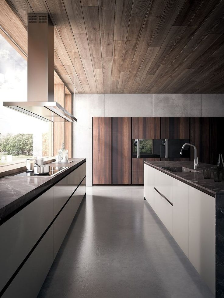 Ceiling paneling. Paneling on the built-ins. Clean lines. Stove top hood.