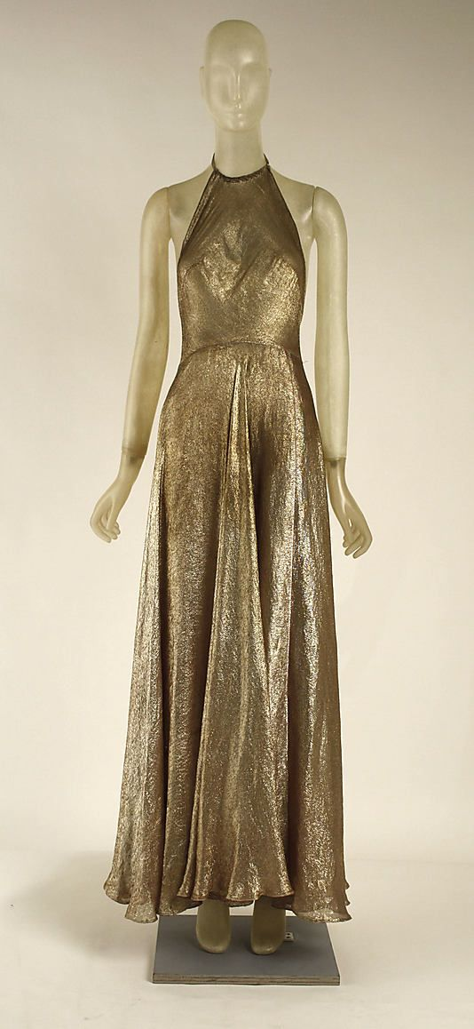 Dress, Evening  Madeleine Vionnet (French, Chilleurs-aux-Bois 1876–1975 Paris)  Date: 1939 Culture: French Medium: cotton, metallic Dimensions: Length at CB (a): 63 in. (160 cm) Credit Line: Gift of Mrs. Harrison Williams, 1952