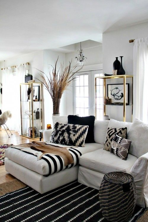 The best thing about this photograph is those brass shelves. I garbage-picked them two weeks ago. Rug, pillows and stool are all Nate Berkus from Target.: