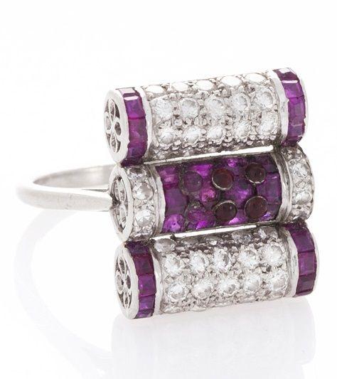 An Art Deco platinum, diamond and ruby ring.