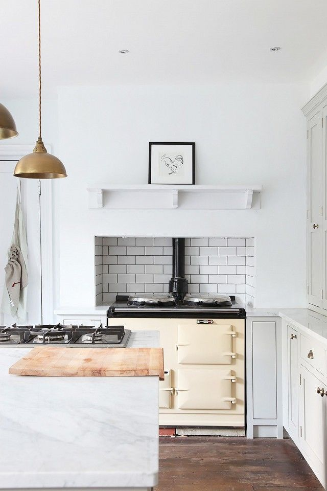 Interior designers are proving that white and cream can coexist in the kitchen. The key is restraint; choose a specific accent such as a range hood and use cream in place of a statement color....