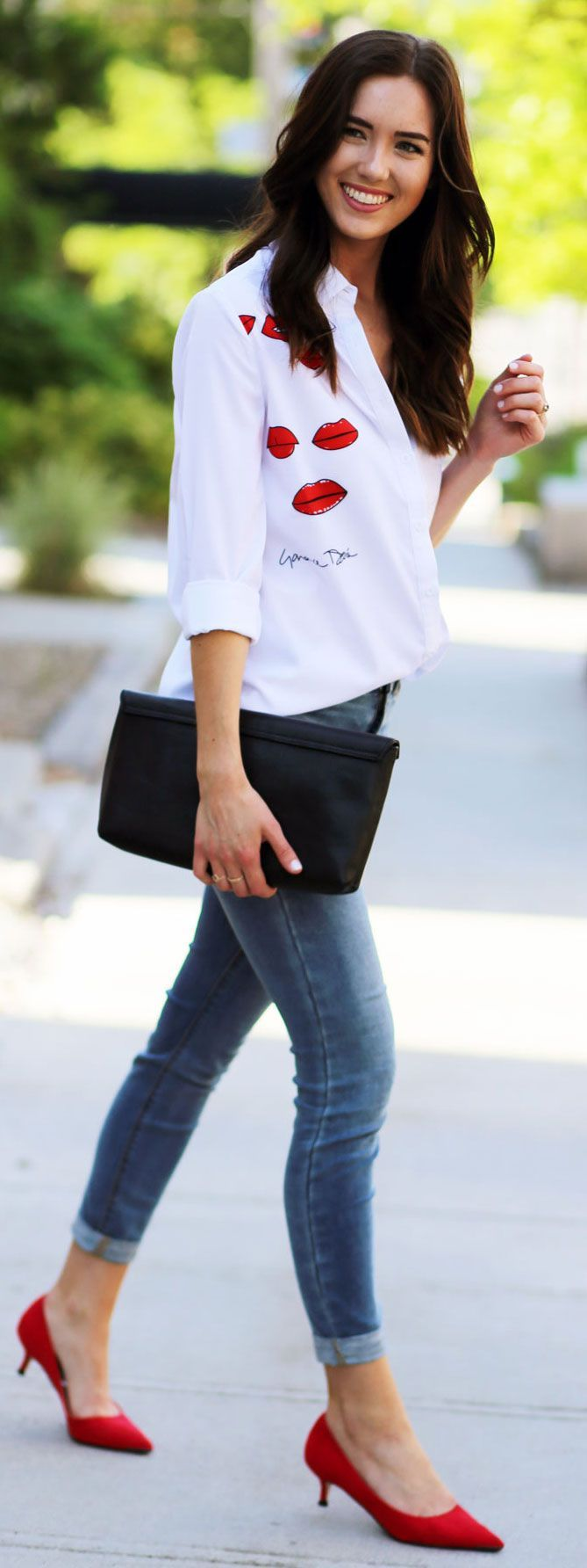 OMG how cute is this white buttons down shirt with red kisses lips all over?! Perfect outfit for Fourth of July! Shirt is less than $20! Fashion blogger Marie's Bazaar shows how to wear it for a casual date night with red kitten heels