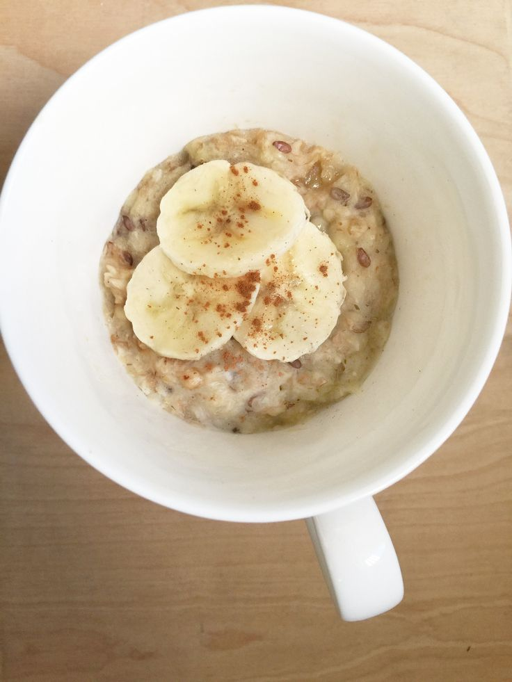 This microwaveable mug oatmeal with peanut butter and banana will make you feel like you're eating cookies for breakfast.... we swear.