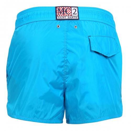 LIGHT-BLUE NYLON SWIM SHORTS - Light-blue Nylon Swim Shorts with two front pockets and a single snap-button back pocket. Internal net. Elastic waistband with adjustable drawstring. #mrbeachwear #mc2 #boardshort #fashion #man #summer #style