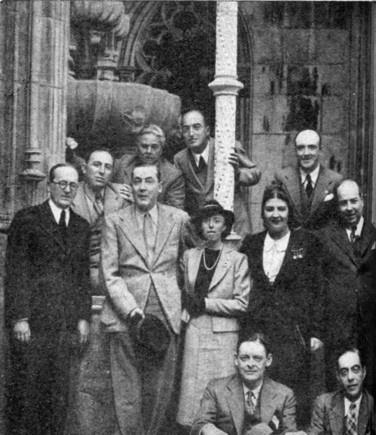 T. S. Eliot in Sintra (Portugal) 1938:  Seated are T. S. Eliot and Guilherme Pereira de Carvalho, editor of «Lisbon-Courier». — Middle row (from the left): Robert de Traz, Jacques de Lacretelle, Mme de Lacretelle, Mme. A Ferro, António Ferro — Upper row (from the left): Máximo Buontempelli, Aldo Bizarri, J. Silva Dias.