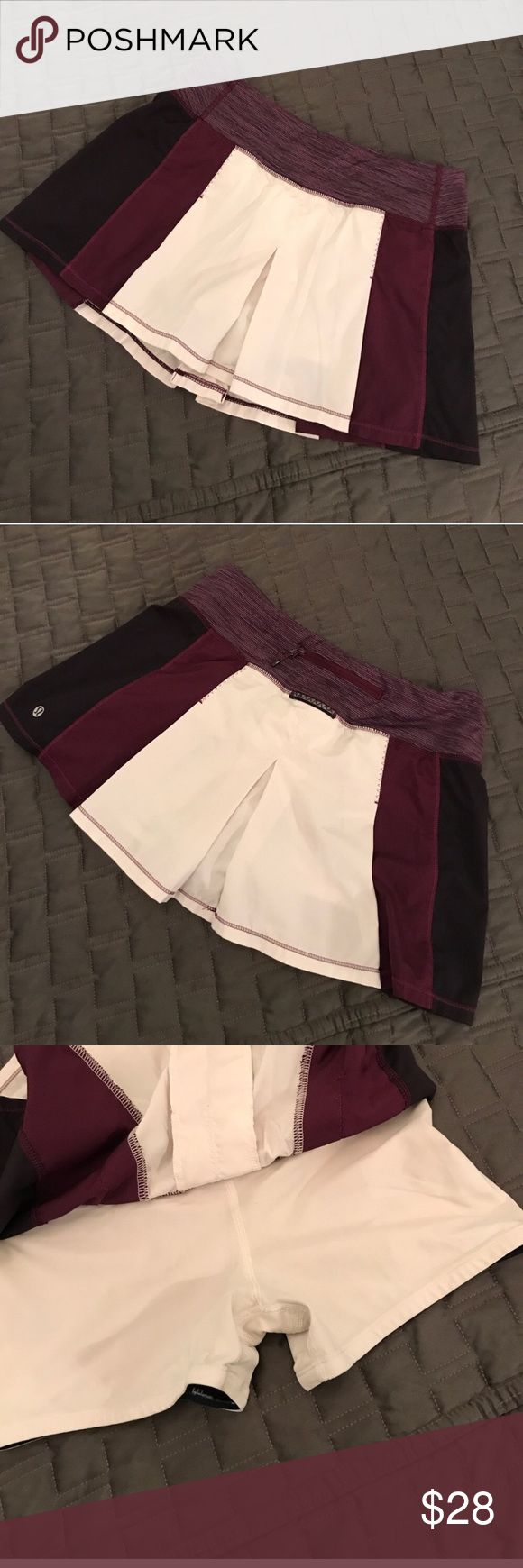 Lululemon burgundy tennis skirt Cream burgundy and black skirt with white under shorts. Back zipper pocket. Unsure of size cannot locate size dot. This is a reposh due to being too small. Original seller said size 6 but I feel this is more of a 2/4. Excellent condition, no flaws!! lululemon athletica Skirts