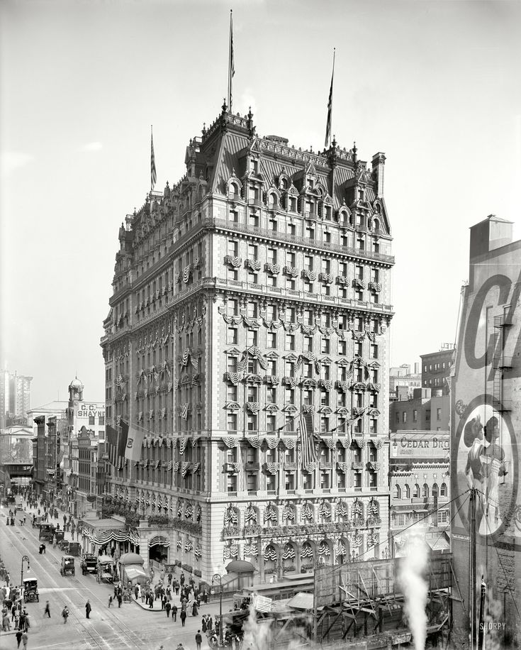 "New York, 1909. ""Knickerbocker Hotel, Broadway & 42nd Street."" Decked out for the Hudson-Fulton Celebration."