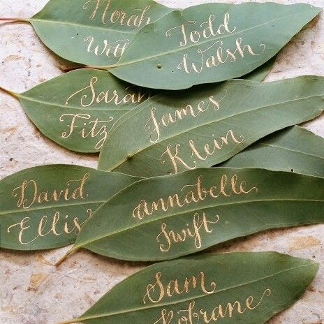 Unique weddinh place card idea - gold calligraphy on fresh leaves