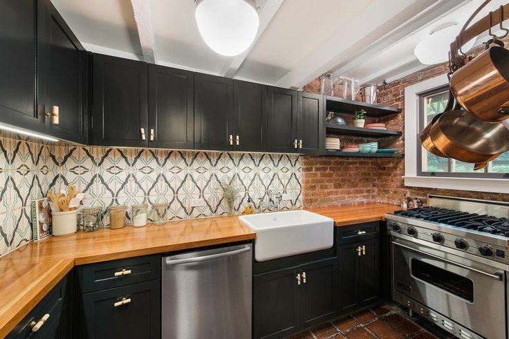 A recently renovated Chef's kitchen—complete with butcher block countertops—and a dining area with terra cotta tile floors and an office nook.