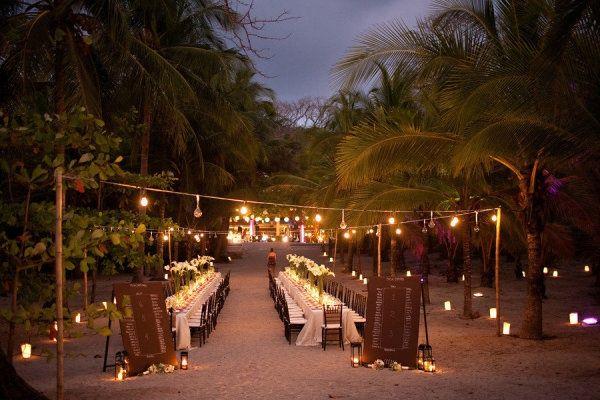 Long wedding table setting on the beach