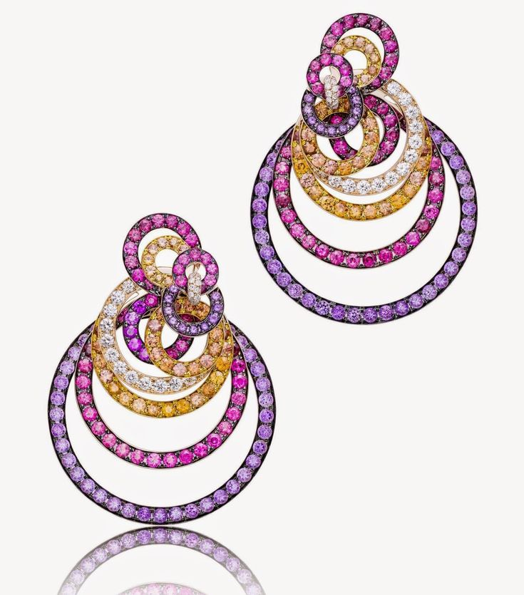 http://www.jewelsdujour.com/wp-content/uploads/2015/02/De-Grisogono-Gypsy-Earrings-Pink-and-black-gold-set-with-amethysts-spinels-orange-sapphires-and-diamonds.jpg
