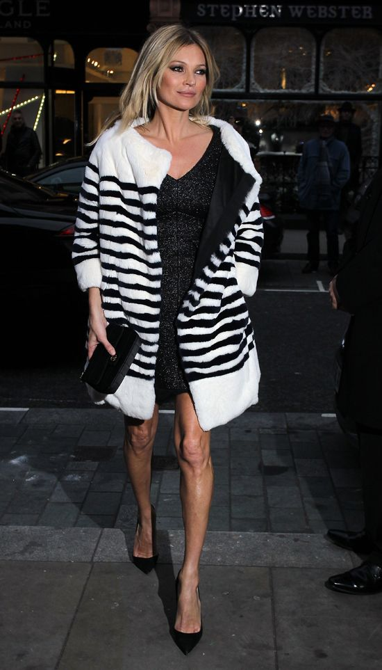 Kate Moss warms up in a pretty fabulous striped black and white coat