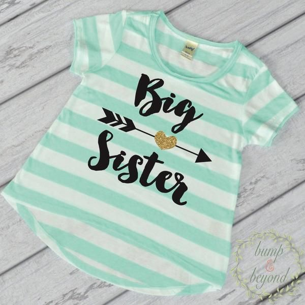 """Big Sister"" Shirt - This adorable high-low short sleeve top makes a great photo prop for pregnancy announcements! It features an all-over stripe print for a fu"