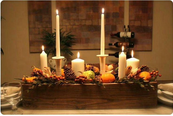 Centrotavola candele e frutta