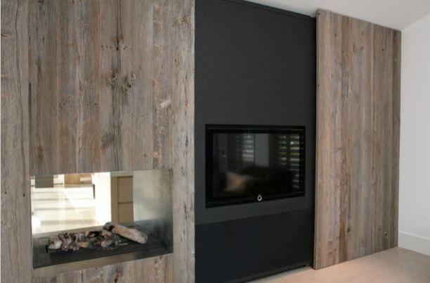 TV wand met kamerhoge schuifwand...heerlijk als je je tv even uit het zicht kan plaatsen!