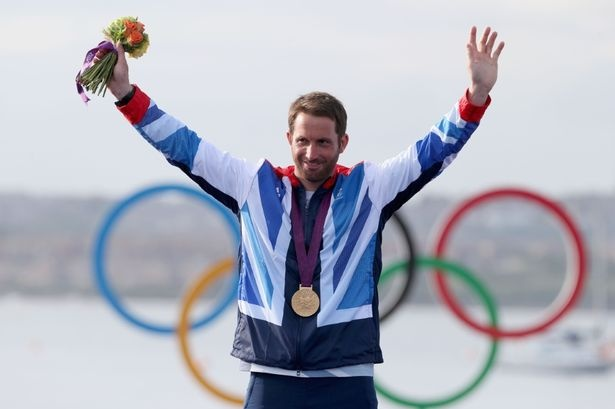 Ben Ainslie of Great Britain celebrates overall victory after competing in the men's Finn Sailing medal race on Day 9.
