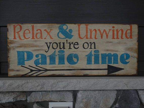 Relax & Unwind youre on Patio time. This outdoor sign would look great on the Patio or porch and add some charm when you are sitting outside enjoying the warmer weather. I designed this sign myself, as of now there is not another one like it... I try to make all my signs fun and original. This sign is 25x10 painted a white/cream color, the words are painted orange, turquoise and black. The whole sign is sanded to distress and a coat of stain is brushed on the back and the front to gi...