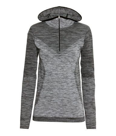 Long-sleeved, hooded top in fast-drying, jacquard-patterned functional fabric. Zip at front. Seamless. | H&M Sport