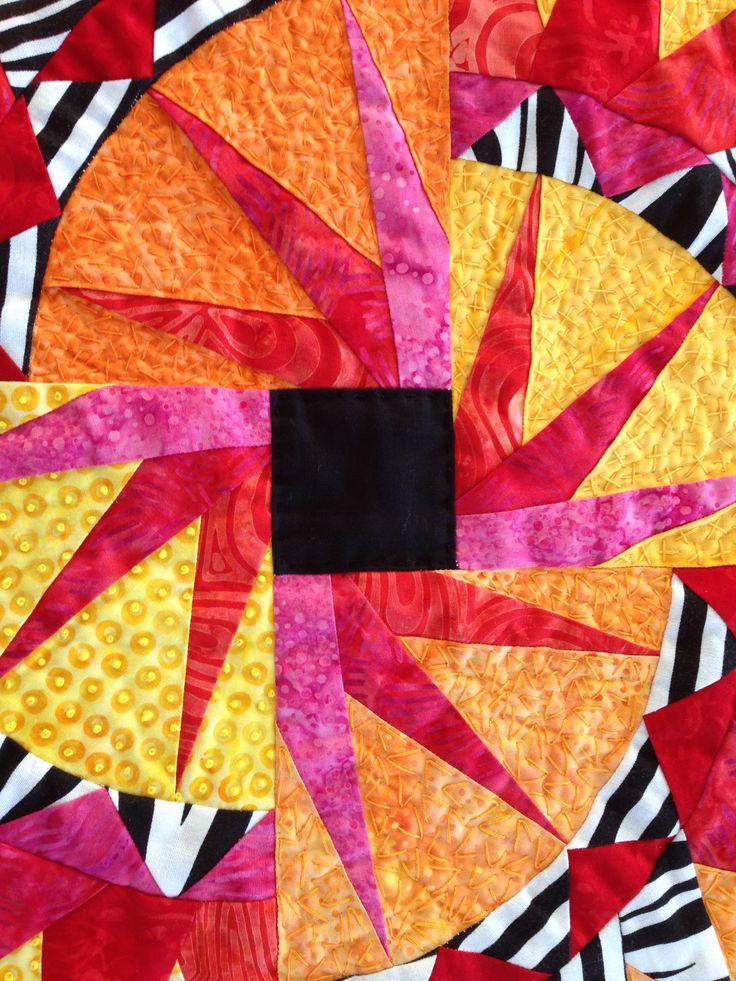 Detalje fra quilten Fyrværkeri. Tæt quiltning med franske knuder, speckling, skæve krydssting og v-sting.