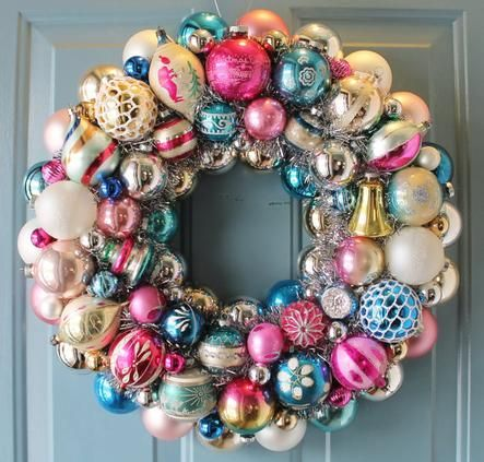 A wreath made from a collection of vintage ornaments.