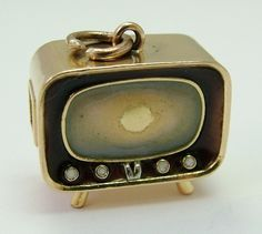 A large 1960's 18k 18ct gold television charm with enamel screen surround and buttons.