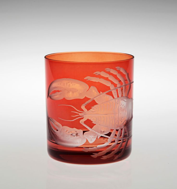 Hand engraved and mouth blown Lobster glass.  Available in other colours.