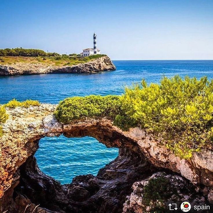Repost from @spain: Portocolom Lighthouse is located on the northeast tip of the bay of Portocolom. It was lit for the first time in 1863. One of the most distinctive and photographed lighthouses on Mallorca Island. With blue and white wide stripes has also been the focus of numerous pictures and paintings.  It is one of the most estimated symbols by the inhabitants of Portocolom and a walk totally recommended. Thanks for sharing @powellpicsblingbling!!  #mallorca #spain #illesbalears…