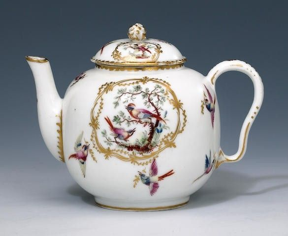 Paris (Duc d'Orléans factory) teapot and cover circa 1786-89 Of globular shape, the domed cover with a bud spray knop, painted with vignettes of exotic birds within scroll-edged cartouches, further birds in flight scattered around, the rims gilt, 12.8cm high, inscribed in underglaze blue .LP. under a crown (minor wear to gilt rims) (2) Paris (Duc d'Orléans factory) teapot and cover circa 1786-89 Of globular shape, the domed cover with a bud spray knop, painted with vignettes of exotic birds…