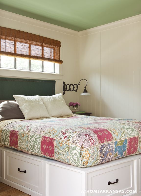 A platform bed provides extra drawers for linen storage.