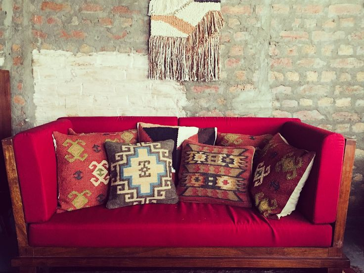 When it comes to decor, throw the idea of perfection out of the window. Play around with textures, colours, patterns, and material to attain decor nirvana in your style. #Tezerac #GlobalDesigns #Furniture #Decor #cushion #red #sofa #macrame #wood #industrial