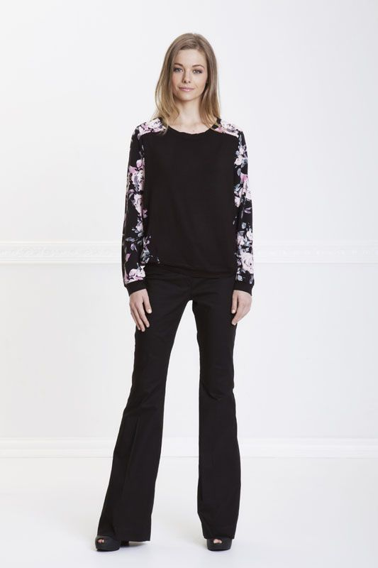 BLACK FLARED PANTS.   GREAT PAIR OF PANTS THAT WILL TAKE YOU FROM WORK TO AN EVENING OUT     Available in sizes 30-40  Email: melissa@hermannarush.com