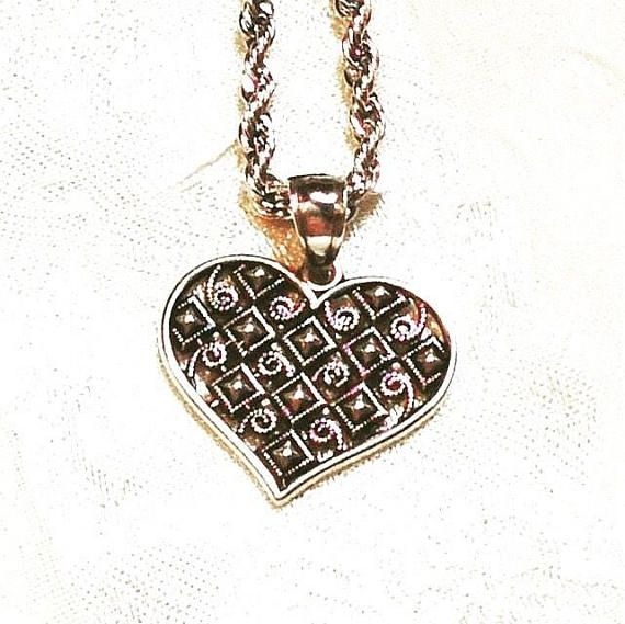 Medieval Harlequin Heart Necklace In Sterling Silver Etched for Light Reflection, Handmade By NorthCoastCottage Jewelry & Design & Vintage. This is a beautiful sterling silver heart pendant and necklace with a delicate medieval diamond and spiral Harlequin pattern etched all through