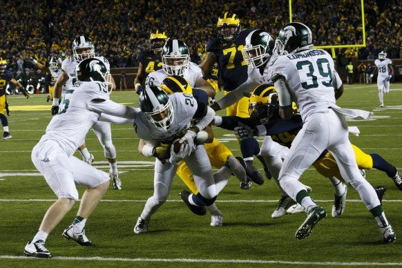 Oct 17, 2015; Ann Arbor, MI, USA; Michigan State Spartans defensive back Jalen Watts-Jackson (20) dives into the end zone for a game winning touchdown as the clock runs out in the fourth quarter against the Michigan Wolverines at Michigan Stadium. Michigan State 27-23. Mandatory Credit: Rick Osentoski-USA TODAY Sports