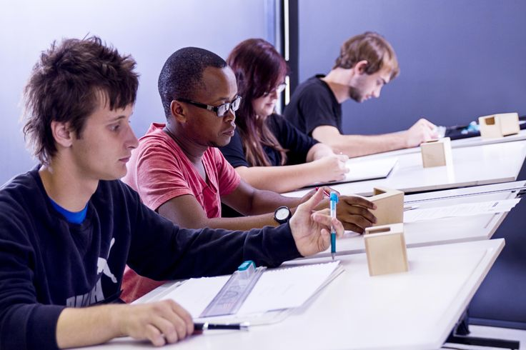 Students working on technical drawings in the 3D Design class.